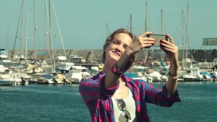 woman model shooting selfie  against of yacht club