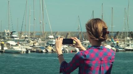 blond girl model shooting panoramic video photo on yacht club