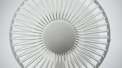 An electric fan close up, rotates and stops
