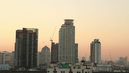 Bangkok : April 21,2015- Sunset sun setting into downtown