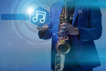 Music concept. musician with a saxophone icon clicks on the virt