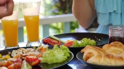 Couple Enjoying Breakfast - Scrambled Eggs and Croissants