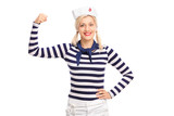 Blond female sailor showing her bicep