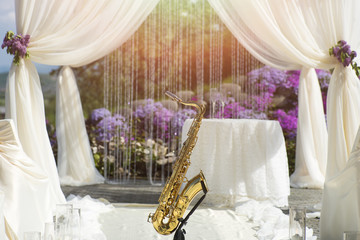 Gold saxophone in wedding ceremony decoration