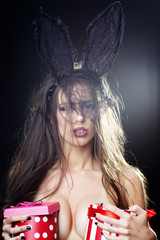 Alluring naked pretty woman with bunny ears and gifts