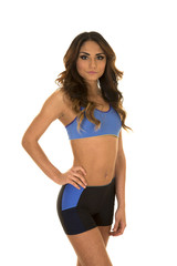 woman in blue fitness attire hand on hip