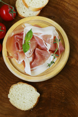 traditional Italian meat appetizer parma ham (jamon)