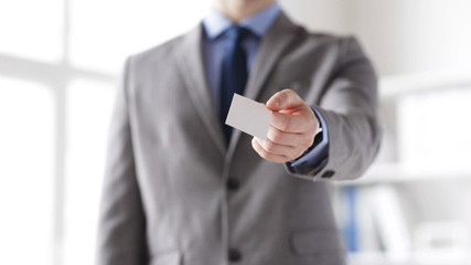 close up of businessman giving white blank card