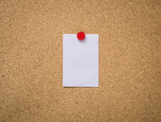 Close up cork board with blank note paper
