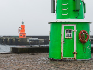 Two old lighthouses in the rainy day