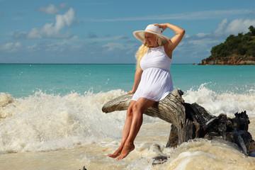 women enjoying sea waves