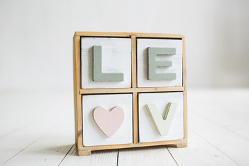 Love decorative letters on the white wooden background