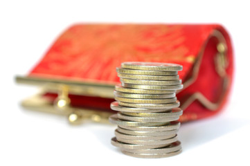 Coins and small purse on white background