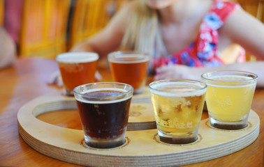 Craft beers  in a sampler tray  at a restaurant
