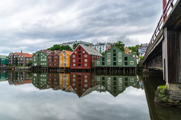 Trondheim river front under cloudy sky