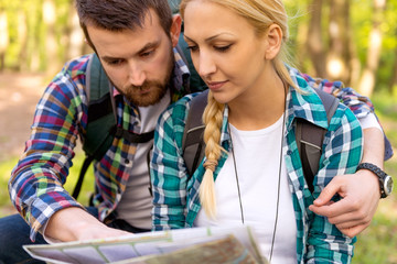 Hikers looking at map
