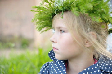 Portrait of girl with a grass wreath on  head