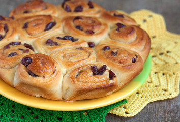 Traditional English buns Chelsea with dried cranberries