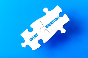 Connected puzzle pieces with text ONLINE MARKETING