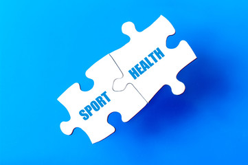 Connected puzzle pieces with words  SPORT and HEALTH