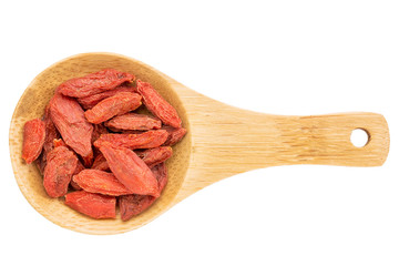 goji berries on wooden spoon