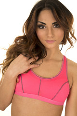 woman in pink sports bra head close looking
