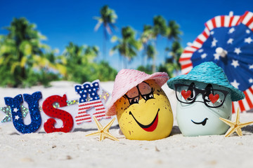 Happy eggs on ocean beach during patriotic holiday