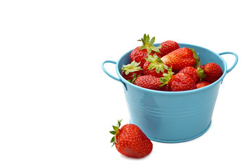 Bowl of fresh strawberries isolated on white background