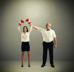 referee holding winner businesswoman