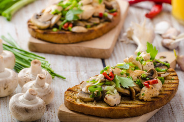 Toast with mushrooms and fried chicken, sprinkled with