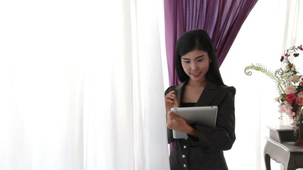 Young woman using  tablet and thinking some idea