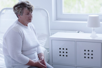 Retired woman in hospital room