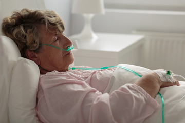 Sick woman with nasal cannula