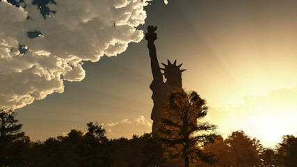 Statue of Liberty on the background of sunset