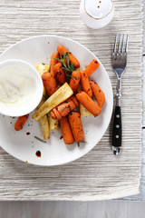 Carrots with parsnips on a plate