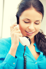 businesswoman with rotary phone calling