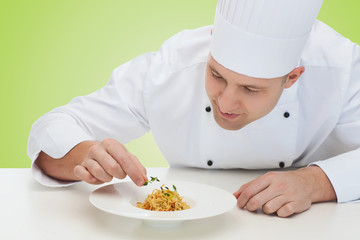happy male chef cook decorating dish