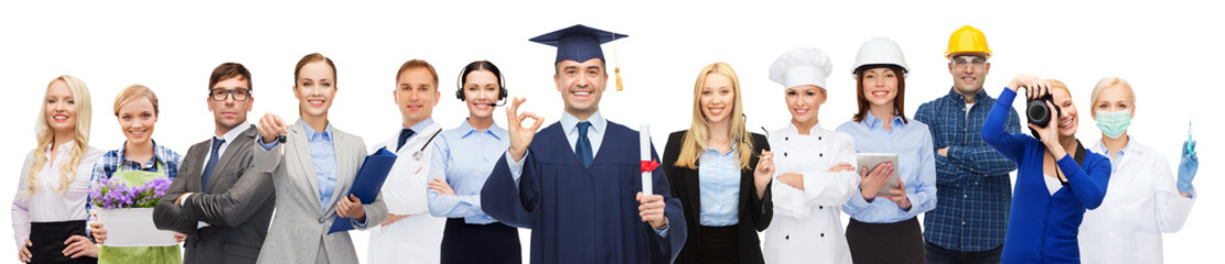 happy bachelor with diploma over professionals