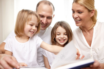 happy family reading book at home