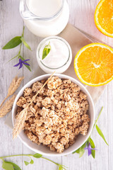 bowl of cereal with milk and orange
