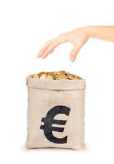 Bag of coins with hand isolated on a white background