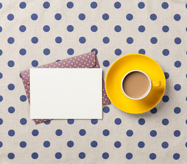 Cup of coffee and envelope