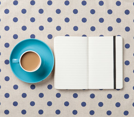 Cup of coffee and notebook