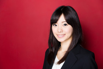 asian businesswoman on red background