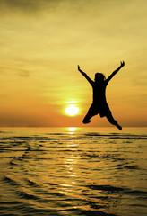 Girl jump welcome sunrise