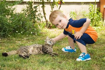 Boy caressing a cat