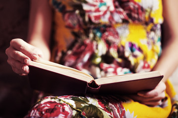 Close-up image of woman reading book.