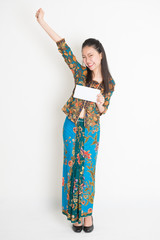 Happy Asian female showing an envelope
