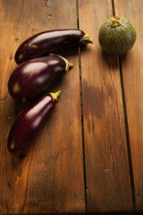 Fresh eggplant and zucchini on picnic table background