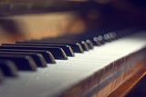 Fototapety Piano keyboard background with selective focus